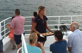 Graze on fresh seafood and enjoy the view on Whalesong's sunset and seafood cruise