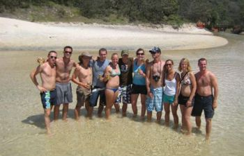 Swim and frolick on the beach of Fraser Island on the Fraser Experience Tour