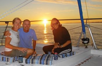Catch up with friends while enjoying the beautiful scenery on the Champagne Sunset Sail cruise from Hervey Bay